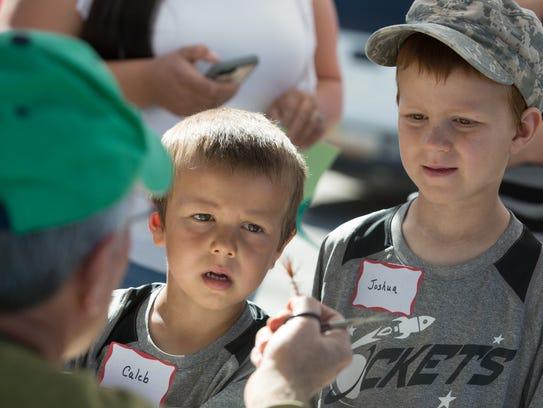 Caleb Greenwood, 5, and his brother Joshua, 7, both
