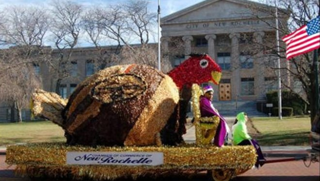 The turkey float drives by New Rochelle City Hall during last year's Thanksgiving parade.
