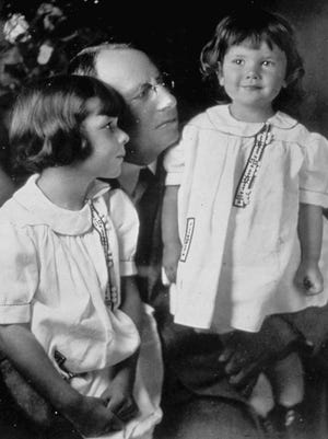 Gov. James M. Cox bought the Dayton Daily News in 1898, starting a media company that would eventually own The Palm Beach Post and Palm Beach Daily News for nearly 50 years. In this 1924 portrait, Anne, 5, left, and the governor admire Barbara, 2. When their half-brother Jim died in 1974, the sisters owned Cox Enterprises through a trust inherited from their father. Gov. Cox died in 1957 at 87. Barbara Cox Anthony died in 2004 at 84. Anne Cox Chambers died Jan. 31 at 100. Her grandson Alex Taylor, a former publisher of The Post and Daily News, is now CEO of Cox Enterprises.