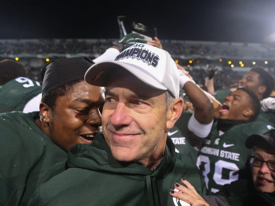 Michigan State coach Mark Dantonio on the field after his team defeated Penn State, 55-16, on Nov. 28 at Spartan Stadium.
