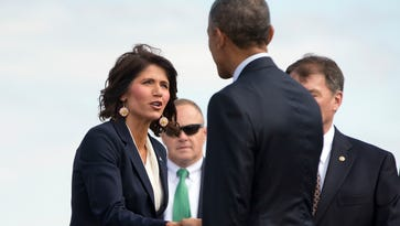 President Obama is greeted by Rep. Kristi Noem, R-S.D., during his arrival on Air Force One at Watertown Regional Airport in May 2015.