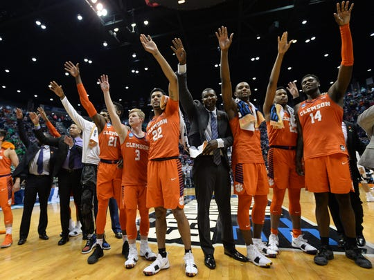 The Clemson Tigers celebrate after a victory over the