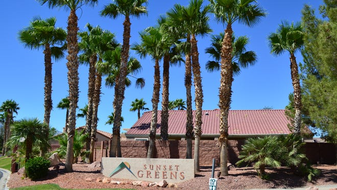 The entrance to Sunset Greens is shrouded in the shade of trees. Nevada passed AB 125, a bill that changes construction defect laws making it harder for homeowners and HOAs to sue.