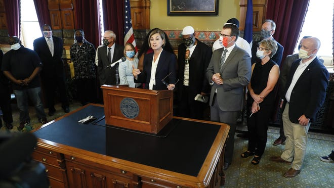 Iowa Gov. Kim Reynolds speaks after signing an executive order granting convicted felons the right to vote during a signing ceremony Wednesday at the Statehouse in Des Moines.