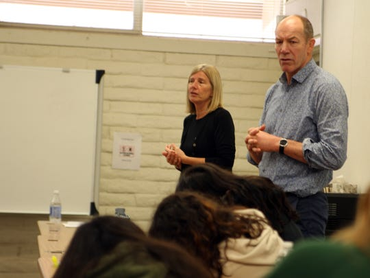 Mary Wootton and Brian Annan listen to students talk about their Infinity Learning Maps