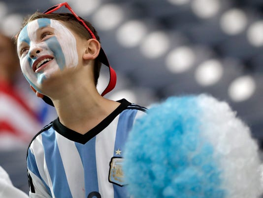 An Argentina fan pauses in the stands before a Copa America Centenario semifinal soccer match between the United States and Argentina Tuesday, June 21, 2016, in Houston. (AP Photo/David J. Phillip)