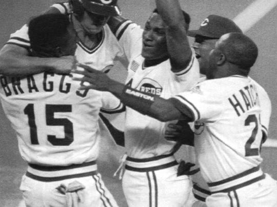 (From left:) Glenn Braggs, Billy Bates (with helmet, who scored the winning run), Eric Davis, Jose Rijo and Billy Hatcher celebrate after the Reds beat the Oakland Athletics 5-4 to go up 2-0 in the 1990 World Series.
