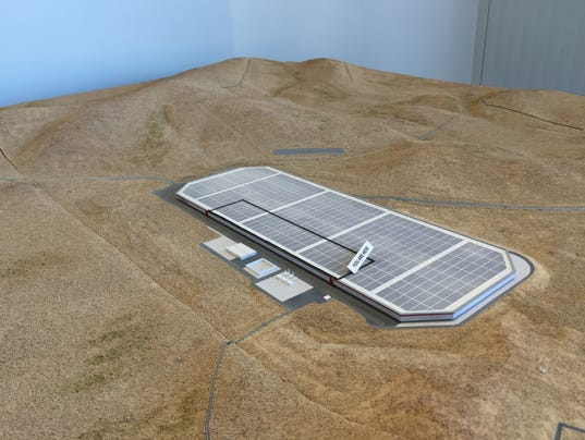 This scale model of gigafactory and surrounding land is on display in ...