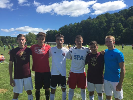 636074737773938971-Arlington-soccer-s-Mountain-Boys.JPG