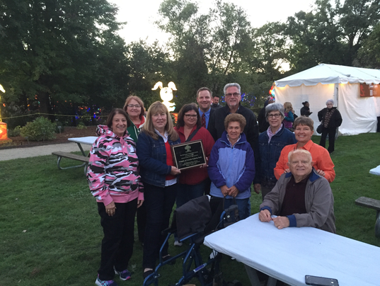 636108574228236534-Friends-of-Pulaski-Park-with-plaque.png