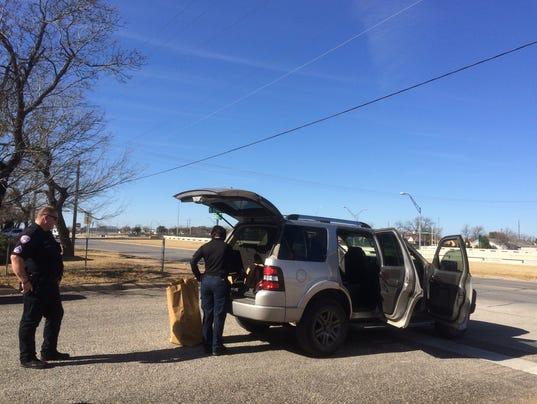 SAPD's Crime Scene Investigation unit working on the vehicle at Bishop & Caddo.JPG