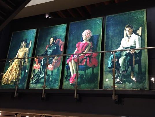 636336415042178639--L-R-Portraits-of-Hunger-Games-characters-Johanna-Jena-Malone-Cinna-Lenny-Kravitz-Effie-Trinket-Elizabeth-Banks-and-Finnick-Sam-Claflin-.JPG