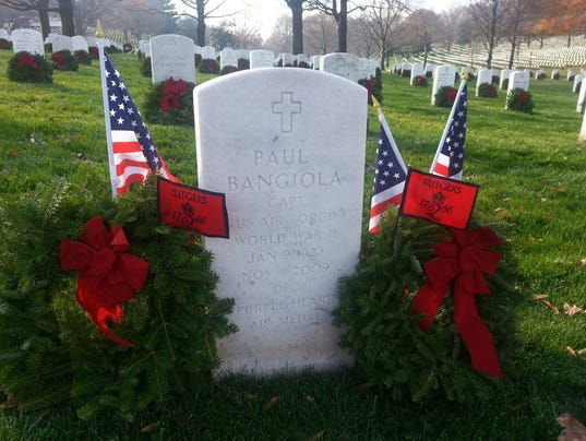 Rutgers flag adorns wreath on alumnus grave in Arlington National Cemetery