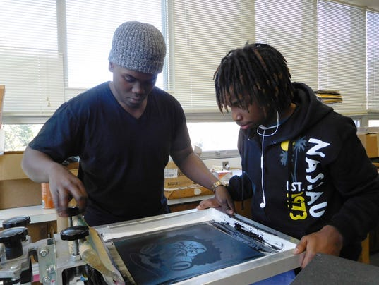 636516932455921227-Hosea-Washington-Jr.-and-Quincy-Cameron-make-tiny-adjustments-for-perfect-registration-of-the-print.JPG