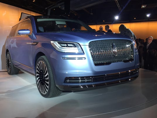 Lincoln navigator with gullwing doors stuns at new york for Wing motors automobiles miami fl