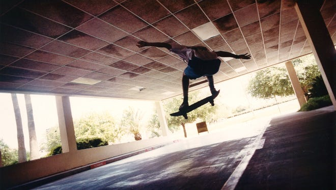 Tim Johnson, 18, soars off a curb on his skateboard June 28, 1992 at the Nueces County Courthouse parking garage.