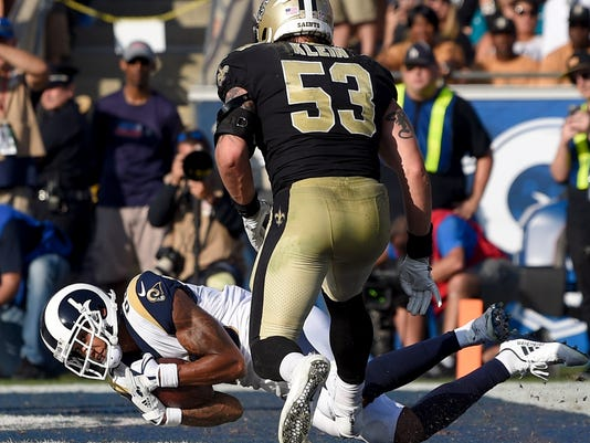 Los Angeles Rams wide receiver Josh Reynolds catches a touchdown pass as New Orleans Saints outside linebacker A.J. Klein looks on during the first half of an NFL football game Sunday, Nov. 26, 2017, in Los Angeles. (AP Photo/Mark J. Terrill)