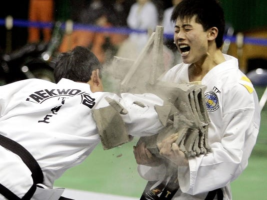 Taekwondo fighters from rival group now OK for Olympics