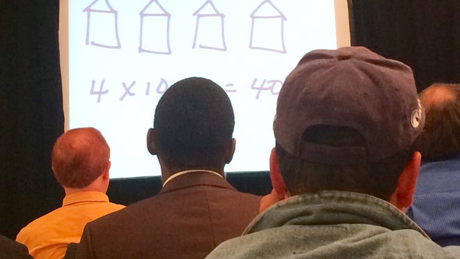 People listen intently to a presentation as part of a three-day real-estate seminar in Columbus, Ohio, in October 2014. Ohio state officials say some of what's taught at these types of seminars is illegal.