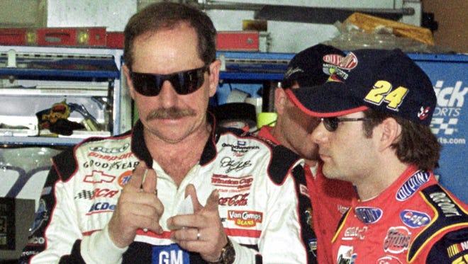 NASCAR driver Dale Earnhardt Sr., left, gtalks to Jeff Gordon inside the garage at the Daytona International Speedway in Daytona Beach, Fla., before a practice run Friday morning Feb. 16, 2001.
