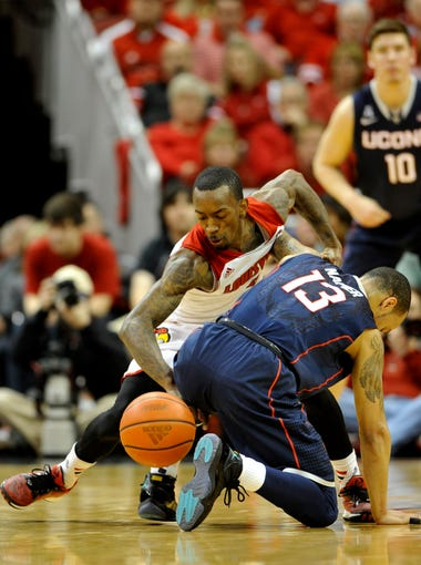 U of L versus U Conn at the YUM! Center.  Russ Smith strips the ball from UConn's Shabazz Napier in the first half. March 8, 2014