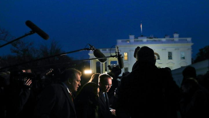 White House budget director Mick Mulvaney is surrounded