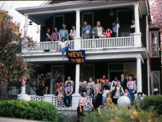 Volunteers pose on the front porch of WEVL's first