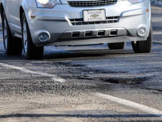 636523092253331678-potholes.kalamazoo.jpg