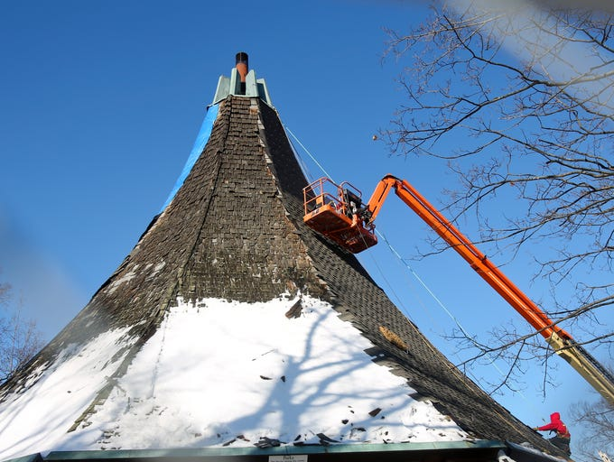 Workers shingle the Hogan Fountain Pavilion in Cherokee Park. Dec. 12, 2013