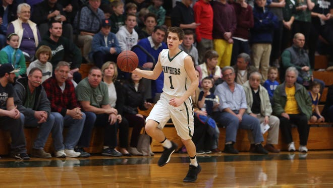 Pleasantville defeated Putnam Valley 56-42 in boys basketball playoff action at Pleasantville High School Feb. 22, 2017. Mike Manley (1) and the Panthers earned their first berth at the County Center since 2010.