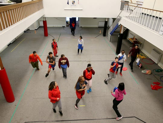 Students from Rochester Academy Charter School use