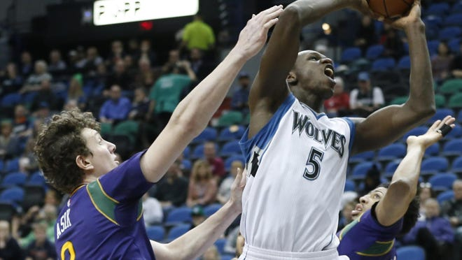 Minnesota Timberwolves' Gorgui Dieng, shown here in a game last season against New Orleans, says he does not care who he plays with as long as he gets to play.
