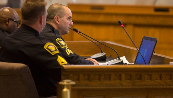 Mon. Aug. 1, 2016: Cincinnati FOP president Dan Hils speaks to city council as other members of the police department sit in attendance.