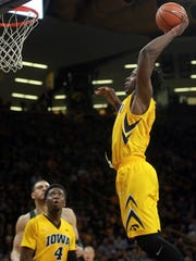 Iowa's Tyler Cook dunks the ball during the Hawkeyes'