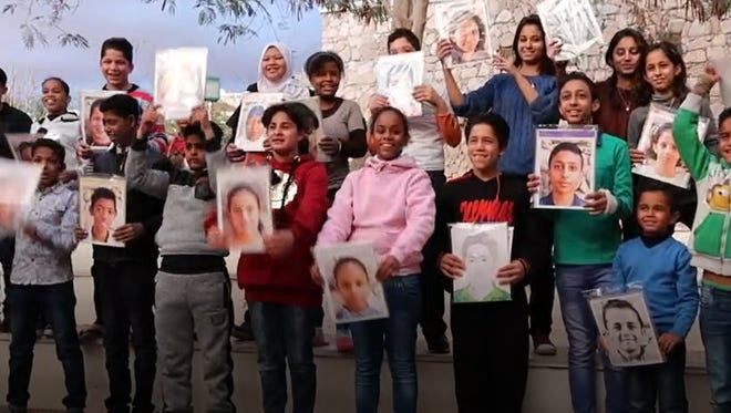 Ithaca High School students that participated in the Memory Project made these portraits that were given to Syrian children.