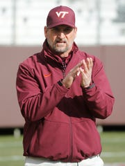 Virginia Tech defensive coordinator Bud Foster cheers his players during warm ups prior to the start of the Virginia-Virginia Tech game last week in Blacksburg, Va.