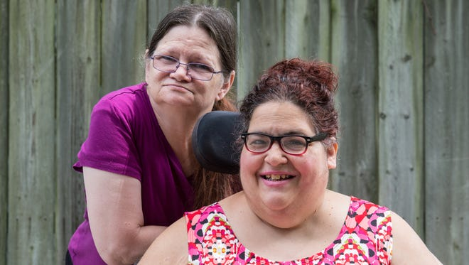 Joana Weaver, right, poses for a photo with her caretaker Robin Johnson at her Georgia Avenue home on Monday, July 17, 2017.