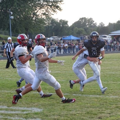 A group of Coshocton defenders run Fairless Qb, Christian