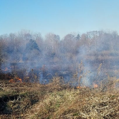 A brush fire rages on Saturday in the town of Poughkeepsie.