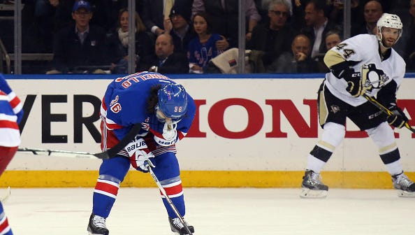 Mats Zuccarello leaves the ice with a head injury during Game 5 of the Rangers' first-round playoff series April 24