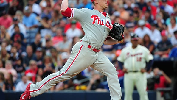 Jeremy Hellickson throws a first inning pitch Saturday against the Atlanta Braves at Turner Field. Hellickson was happy to still be with the Phillies after Monday's non-waiver trade deadline passed.