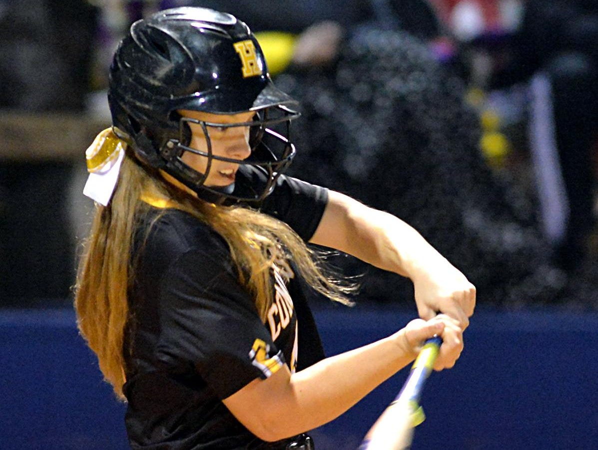 Hendersonville High junior Lexi Revis swings at a pitch during Tuesday evening's jamboree at White House High School.