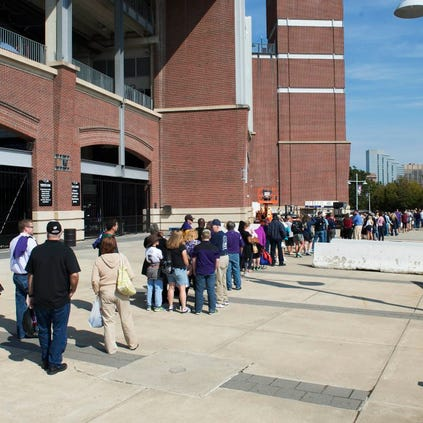 Sep 19, 2014; Baltimore, MD, USA; Baltimore Ravens fans wait in line over an hour to exchange their Ray Rice jerseys for new NFL jerseys at M&T Bank Stadium. Mandatory Credit: Tommy Gilligan-USA TODAY Sports ORG XMIT: USATSI-189418 ORIG FILE ID:  20140919_jla_gb3_005.jpg