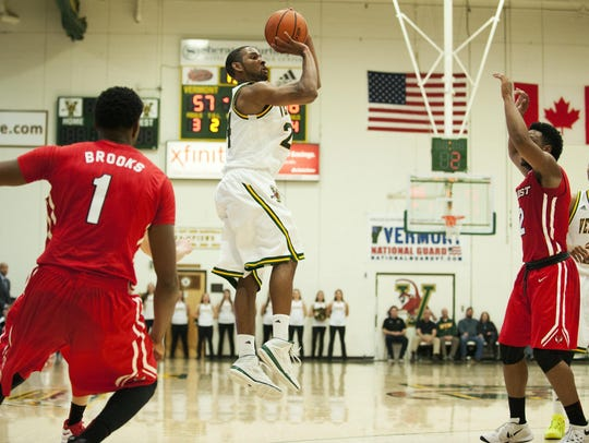 Catamounts guard Dre Wills (24) takes a jump shot during