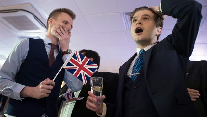 Supporters of leaving the EU celebrate at a party hosted by Leave.EU in central London as they watch results come in from around the country afer Britain voted in a national referendum on whether to stay inside the EU.