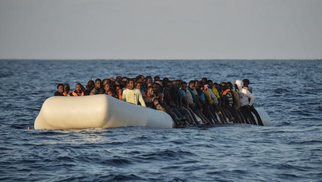 This file photo taken on Nov. 3 shows migrants and refugees on a rubber boat to be rescued by the ship Topaz Responder run by Maltese NGO Moas and Italian Red Cross off the Libyan coast in the  Mediterranean Sea.   / AFP PHOTO / ANDREAS SOLAROANDREAS SOLARO/AFP/Getty Images