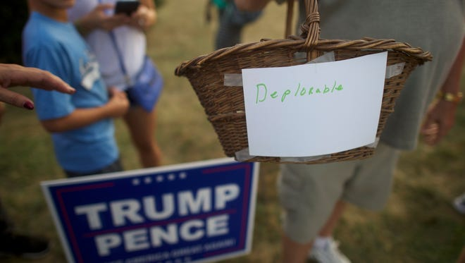 """ASTON, PA - SEPTEMBER 13:  A Donald Trump supporter holds a basket labeled """"deplorable,"""" referencing Democratic Presidential nominee Hillary Clinton's comment about a """"basket of deplorables,"""" before the Republican Presidential hopeful was to hold a campaign event at the Aston Township Community Center on September 13, 2016 in Aston, Pennsylvania.  Recent national polls show the presidential race is tightening with two months until the election. (Photo by Mark Makela/Getty Images)"""