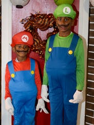 Kids pose in the photo booth at a previous Halloween