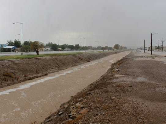 Flood waters rapidly filled the canal along Indian