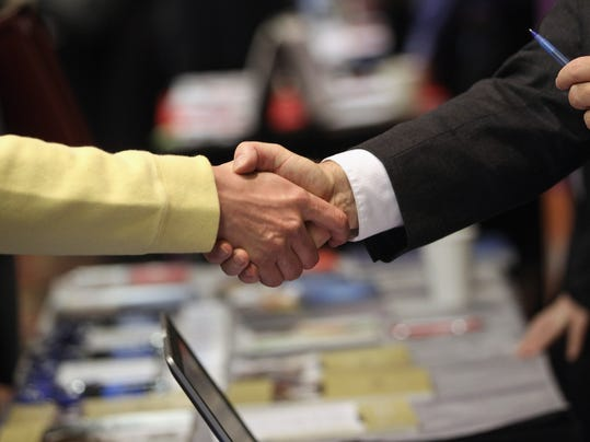 Job Seekers Look For Employment Opportunities At Career Fair